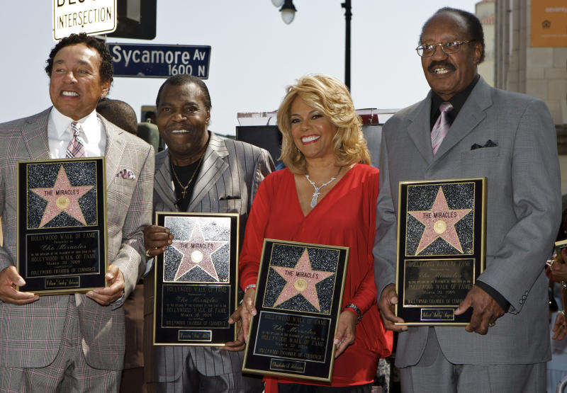 "FILE - In this March 20, 2009 file photo, members of the Motown group The Miracles, from left: William ""Smokey"" Robinson, Warren ""Pete"" Moore, Claudette Robinson, and Robert ""Bobby"" Rogers, are honored with a star on the Hollywood Walk of Fame in Los Angeles. Rogers, a founding member of the group and a collaborator with Smokey, has died. Motown Museum board member Allen Rawls said Rogers died Sunday, March 3, 2013, at his home. He was 73. (AP Photo/Damian Dovarganes, file)"