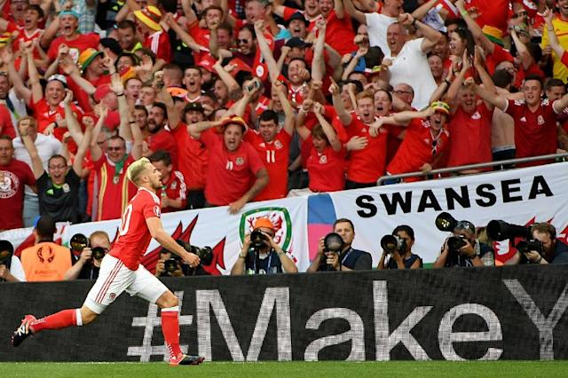 Wales' midfielder Aaron Ramsey celebrates the team's first goal during the Euro 2016 group B football match between Russia and Wales (AFP Photo/Pascal Guyot)