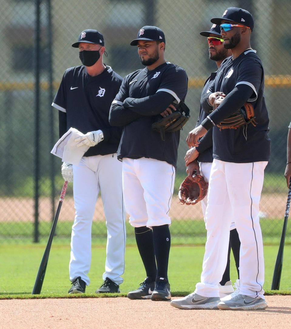Former Tiger Alan Trammell along with infielders Jeimer Candelario (center), Willo Castro and Niko Goodrum (right) listen Monday, Feb. 22, 2021, on the Tiger Town practice fields at Joker Marchant Stadium in Lakeland, Florida. Monday was the first day position players joined pitchers and catchers for spring training.