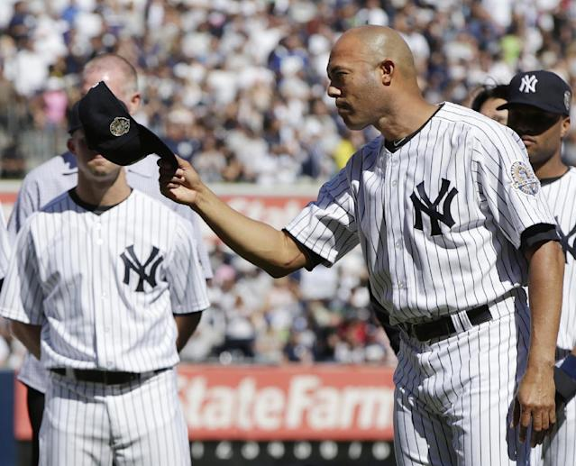 New York Yankees relief pitcher Mariano Rivera (42) tips his cap during a pregame retirement ceremony at Yankees Stadium before a baseball game against the San Francisco Giants, Sunday, Sept. 22, 2013, in New York. The 13-time All-Star closer is retiring at the end of this season. (AP Photo/Kathy Willens)
