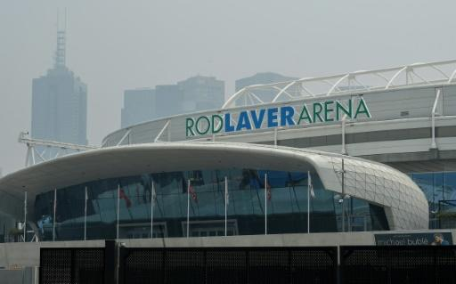 Smoke haze from unprecendented bushfires hovers over the Rod Laver Arena ahead of the Australian Open in Melbourne on Tuesday