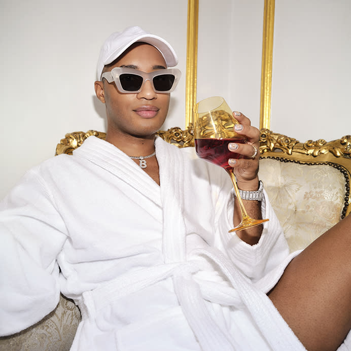 """Brandon Blackwood in a bathrobe and <a href=""""https://fave.co/2WlHlWh"""" rel=""""nofollow noopener"""" target=""""_blank"""" data-ylk=""""slk:Loewe sunglasses"""" class=""""link rapid-noclick-resp"""">Loewe sunglasses</a>.<br>Photo by <a href=""""https://www.instagram.com/sheekswinsalways/?hl=en"""" rel=""""nofollow noopener"""" target=""""_blank"""" data-ylk=""""slk:Shaniqwa Jarvis"""" class=""""link rapid-noclick-resp"""">Shaniqwa Jarvis</a>"""