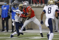 Ohio State receiver Jaxon Smith-Njigba, right, catches a pass in front of Akron defensive back Ronald Jackson during the first half of an NCAA college football game Saturday, Sept. 25, 2021, in Columbus, Ohio. (AP Photo/Jay LaPrete)