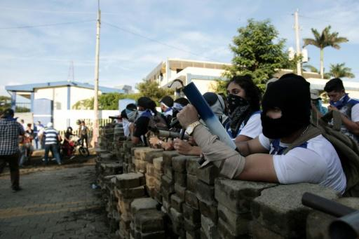 "Anti-government protesters wait behind a barricade in support of ""the Mothers of April"" - whose children died in protests - on Nicaragua's National Mother?s Day in Managua"