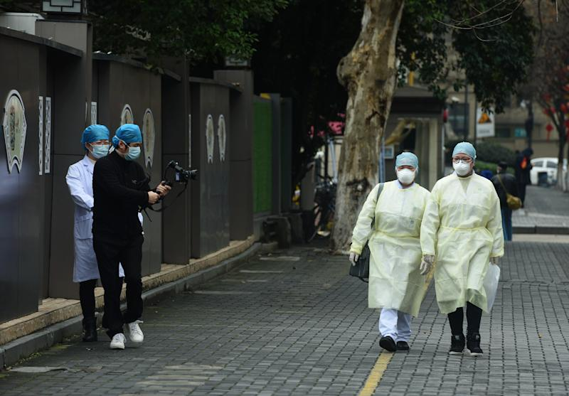 HANGZHOU, CHINA - FEBRUARY 12 2020: Masked people shoot propaganda footage of the fight against Covid-19 in Hangzhou in east China's Zhejiang province Wednesday, Feb. 12, 2020.- PHOTOGRAPH BY Feature China / Barcroft Media (Photo credit should read Feature China/Barcroft Media via Getty Images)
