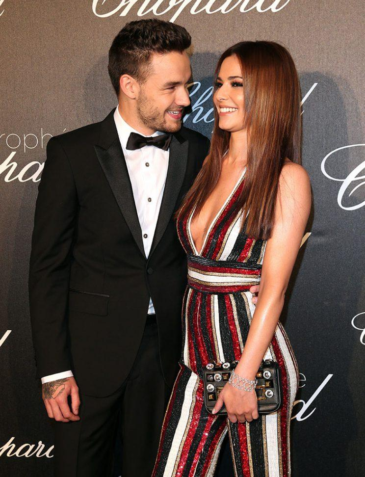 Cheryl Cole (L) and her boyfriend Liam Payne, member of 'one direction' arrive at the Chopard Trophy Ceremony at the annual 69th Cannes Film Festival at Hotel Martinez