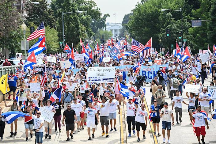 Image: People march during a protest in support of continued anti-government protests in Cuba near the White House on July 26, 2021. (Brendan Smialowski / AFP - Getty Images)