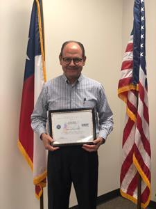 Al Hartman, CEO of Hartman Companies, poses for a picture with his Patriot Award.