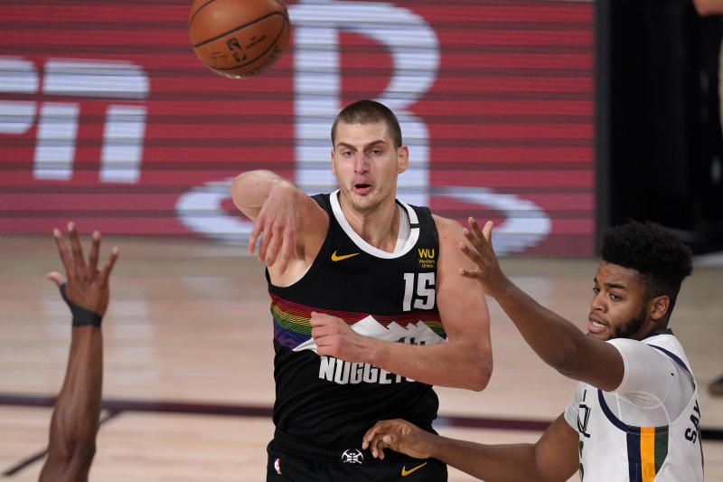 Nikola Jokic capped Tuesday's big performance with a game-winner. (AP Photo/Mark J. Terrill)