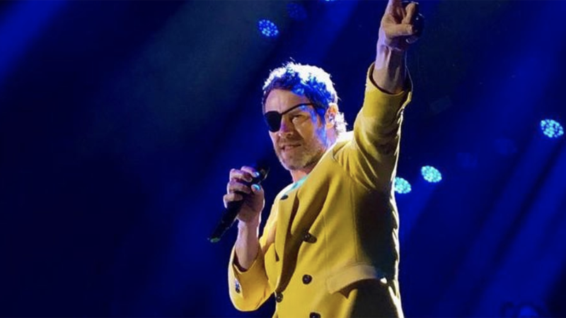 Take That's Howard Donald on stage in Berlin sporting an eyepatch (Credit: Howard Donald/Instagram)