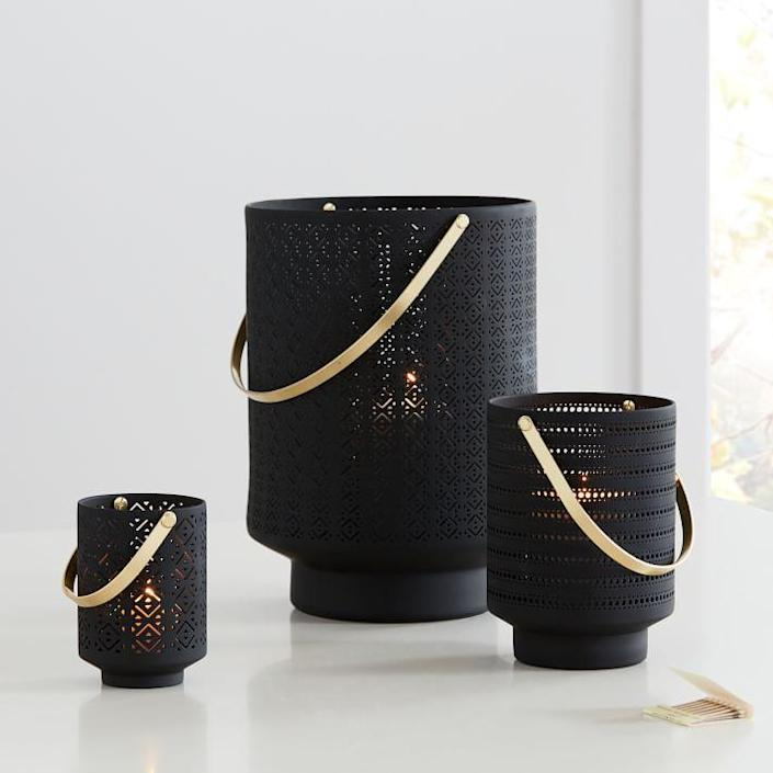 """Set the mood outdoors with these delicate ceramic lanterns (and try a flickering <a href=""""https://www.architecturaldigest.com/story/the-ultimate-light-bulb-shopping-guide?mbid=synd_yahoo_rss"""" rel=""""nofollow noopener"""" target=""""_blank"""" data-ylk=""""slk:LED"""" class=""""link rapid-noclick-resp"""">LED</a> for a fire-free effect). $30, West Elm. <a href=""""https://www.westelm.com/products/modern-porcelain-lanterns-d8670/"""" rel=""""nofollow noopener"""" target=""""_blank"""" data-ylk=""""slk:Get it now!"""" class=""""link rapid-noclick-resp"""">Get it now!</a>"""