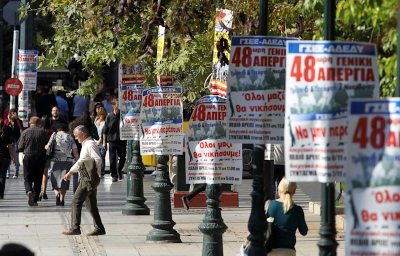 Posters with the title ''All together we'll win'' announce the 48-hour nationwide general strike of Tuesday and Wednesday, in central Athens, Monday, Nov. 5, 2012. Greece is facing three days of escalating anti-austerity strikes, with state hospital doctors, taxi drivers, transport workers and journalists walking off the job. The strikes come as the wobbly coalition government prepares to present another austerity package in Parliament later Monday. (AP Photo/Thanassis Stavrakis)