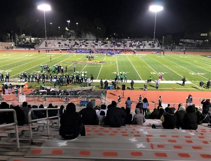 Fans keep socially distanced, sitting in marked spots while avoiding the orange dashes, at Jaguar Stadium on March 12.