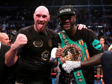 FILE PHOTO: Tyson Fury and Deontay Wilder after their fight at Staples Centre, Los Angeles, United States - December 1, 2018. Action Images via Reuters/Andrew Couldridge/File Photo
