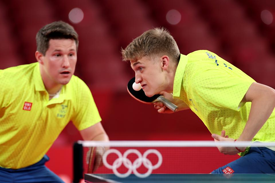 <p>Anton Kaellberg (R) and Kristian Karlsson of Team Sweden in action during their Men's Team Round of 16 table tennis match on day ten of the Tokyo 2020 Olympic Games at Tokyo Metropolitan Gymnasium on August 02, 2021 in Tokyo, Japan. (Photo by Jamie Squire/Getty Images)</p>