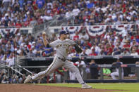 Milwaukee Brewers relief pitcher Jake Cousins (54) deliveres against the Atlanta Braves during the eighth inning of Game 3 of a baseball National League Division Series, Monday, Oct. 11, 2021, in Atlanta. (AP Photo/Brynn Anderson)