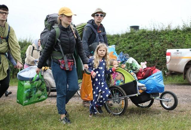 People arrive on the first day of the Glastonbury Festival at Worthy Farm in Somerset