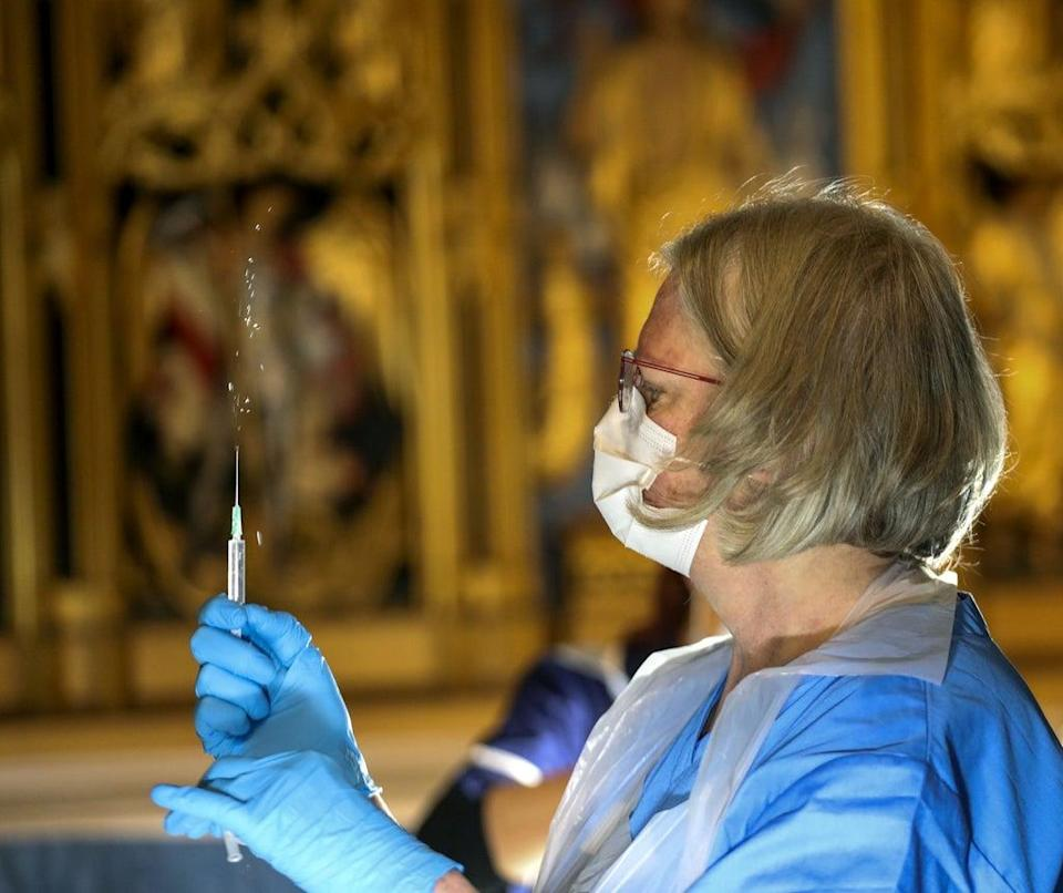 The Pfizer coronavirus vaccine is prepared by a health worker at Salisbury Cathedral, Wiltshire (Steve Parsons/PA) (PA Archive)