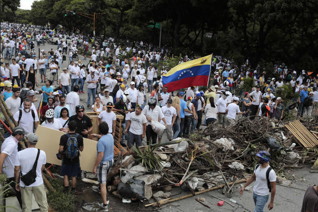 <p>Opposition supporters stand behind a barricade as the Constituent Assembly election was being carried out in Caracas, Venezuela, July 30, 2017. (Marco Bello/Reuters) </p>