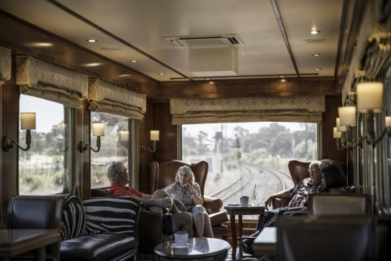 The massive windows of the observation car offer views of the landscapes and cityscapes along the Blue Train's route