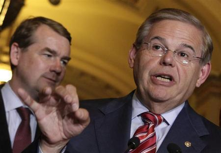 Senate Foreign Relations Committee Chairman Robert Menendez speaks to the media after the Senate passed the immigration bill on Capitol Hill in Washington