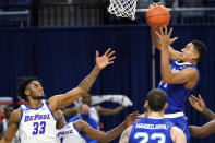 Seton Hall guard/forward Jared Rhoden, right, rebounds the ball against DePaul forward Pauly Paulicap during the second half of an NCAA college basketball game in Chicago, Saturday, Jan. 9, 2021. (AP Photo/Nam Y. Huh)