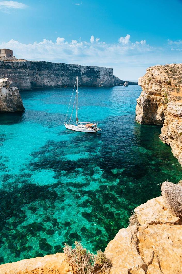 <p>Comino is the smallest of three islands in Malta. It's a tiny little chunk of limestone—one and a half miles long and just under a mile wide—with just a single hotel (Comino Hotel). Still, it's one of the most popular destinations in Malta, mostly thanks to its remote, barren landscape and stunning blue lagoons.</p>
