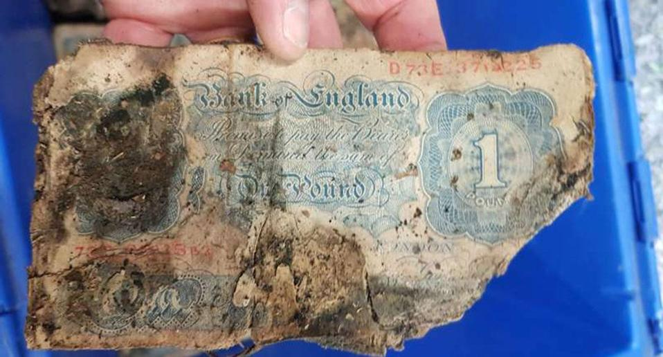 Bundles of decaying Second World War bank notes stashed away in case of Nazi invasion have been discovered under the floorboards of an old clothes store. Source: Sussex Police