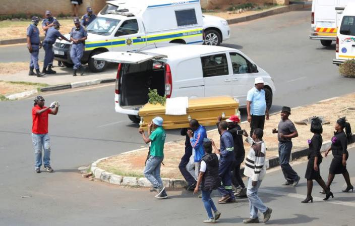 FILE PHOTO: Striking funeral workers in South Africa down tools to demand better work conditions