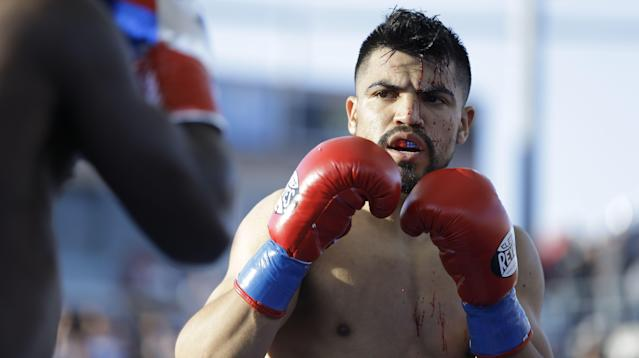 Victor Ortiz was arrested Tuesday and charged with three counts of felony rape. (AP)