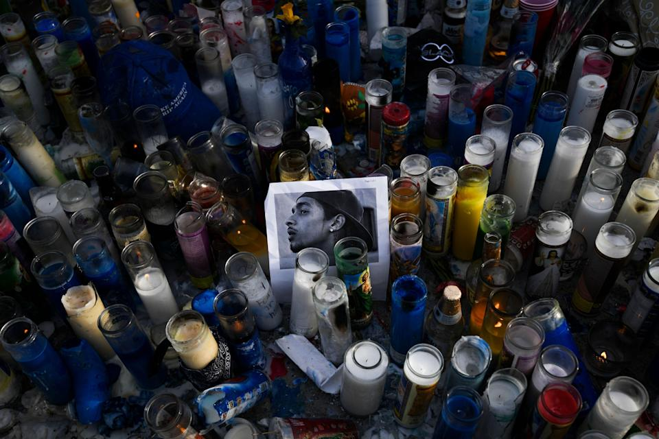 Mourners pay their respects to Nipsey Hussle near his clothing store on April 1, 2019 in Los Angeles. Hussle, a 33-year-old rapper, whose real name was Ermias Asghedom, was shot and killed outside the store on March 31, 2019.