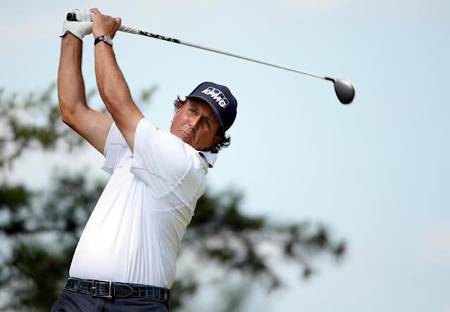 ARDMORE, PA - JUNE 15: Phil Mickelson of the United States hits his tee shot on the fifth hole during Round Three of the 113th U.S. Open at Merion Golf Club on June 15, 2013 in Ardmore, Pennsylvania. (Photo by Ross Kinnaird/Getty Images)