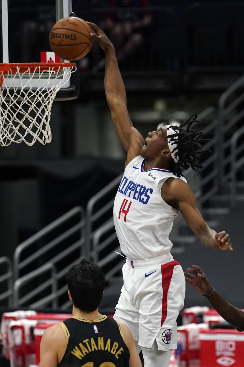 Los Angeles Clippers guard Terance Mann (14) slam dunks the ball over Toronto Raptors forward Yuta Watanabe, of Japan, (18) during the second half of an NBA basketball game Tuesday, May 11, 2021, in Tampa, Fla. (AP Photo/Chris O'Meara)
