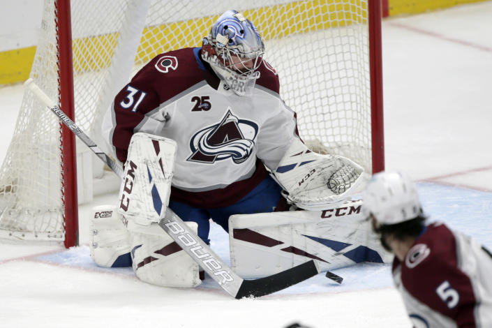 Colorado Avalanche goaltender Philipp Grubauer makes a stop against the Anaheim Ducks during the second period of an NHL hockey game in Anaheim, Calif., Sunday, Jan. 24, 2021. (AP Photo/Alex Gallardo)