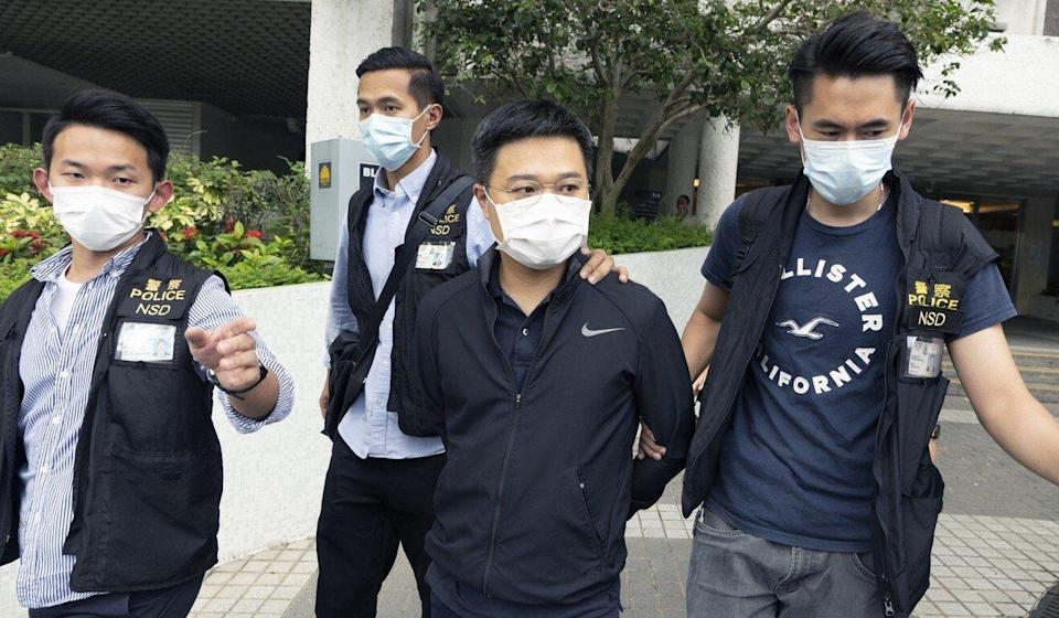 Apple Daily editor-in-chief Ryan Law is taken away by police last Thursday. Photo: Robert Ng
