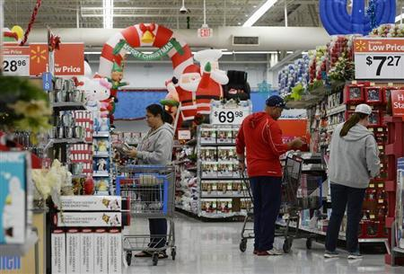 Customers shop for Christmas ornaments at a Walmart store in the Porter Ranch section of Los