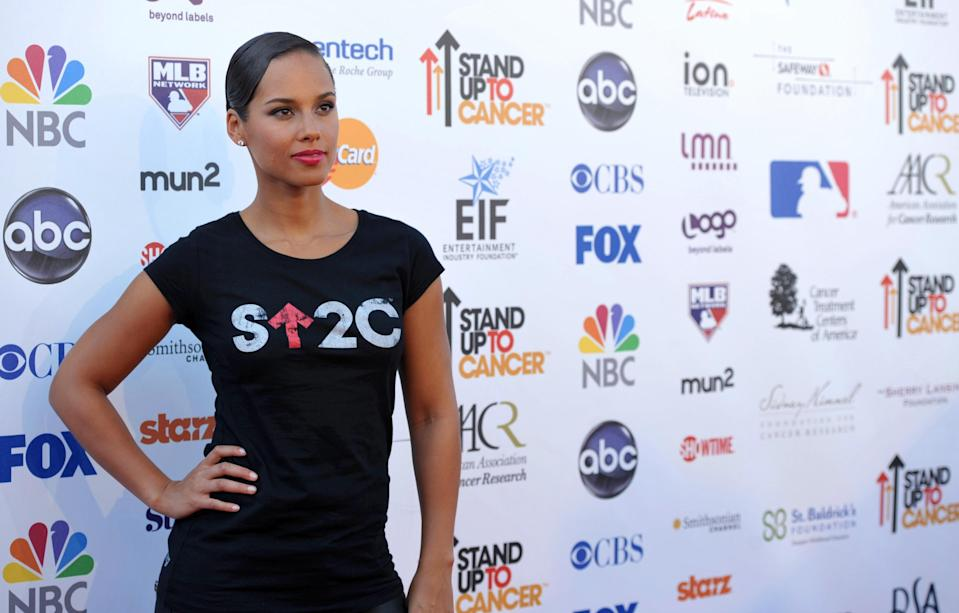 "Musician Alicia Keys attends the ""Stand Up to Cancer"" event at the Shrine Auditorium on Friday, Sept. 7, 2012 in Los Angeles. The initiative aimed to raise funds to accelerate innovative cancer research by bringing new therapies to patients quickly. (Photo by John Shearer/Invision/AP)"