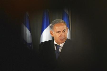 Israel PM Netanyahu speaks during joint news conference with French President Hollande at residence in Jerusalem