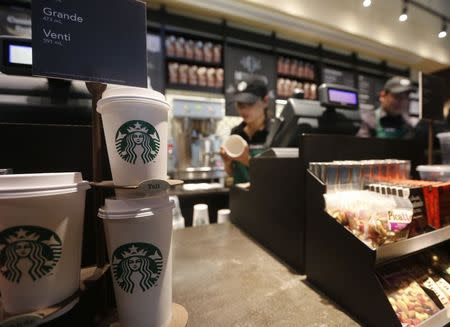 Paper cups of different sizes are seen on display at Starbuck's first Colombian store at 93 park in Bogota July 16, 2014. REUTERS/John Vizcaino