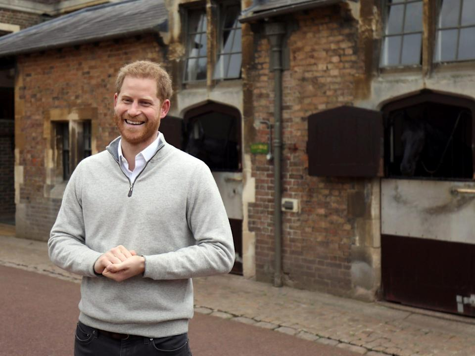 Prince Harry smiles in his first interview after the birth of his son.