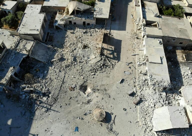 Destruction and damaged buildings from Syrian government forces' bombardment on the village of Al-Tahh in the northwestern Idlib province (AFP Photo/Omar HAJ KADOUR)