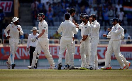 Cricket - India v Australia - Third Test cricket match - Jharkhand State Cricket Association Stadium, Ranchi, India - 20/03/17 - Australia's Matt Renshaw (2nd L) walks off the field as Indian players celebrate his dismissal. REUTERS/Adnan Abidi