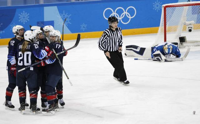 <p>Jocelyne Lamoureux of U.S. (17) celebrates with teammates after scoring her goal. REUTERS/Brian Snyder </p>