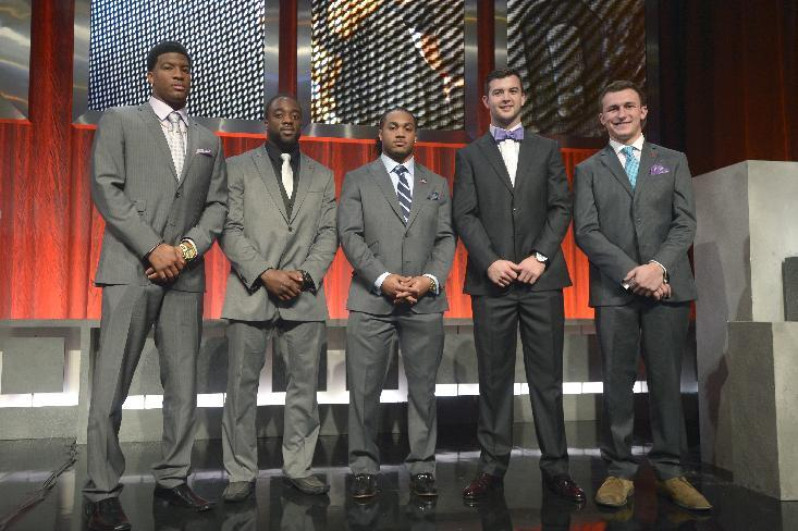 Heisman Trophy finalists Florida State quarterback Jameis Winston, left, Boston College running back Andre Williams, second from left, Auburn running back Tre Mason, center, Alabama quarterback AJ McCarron, second from right, and Texas A&M quarterback Johnny Manziel pose for a photo after the College Football Awards show in Lake Buena Vista, Fla., Thursday, Dec. 12, 2013.(AP Photo/Phelan M. Ebenhack)