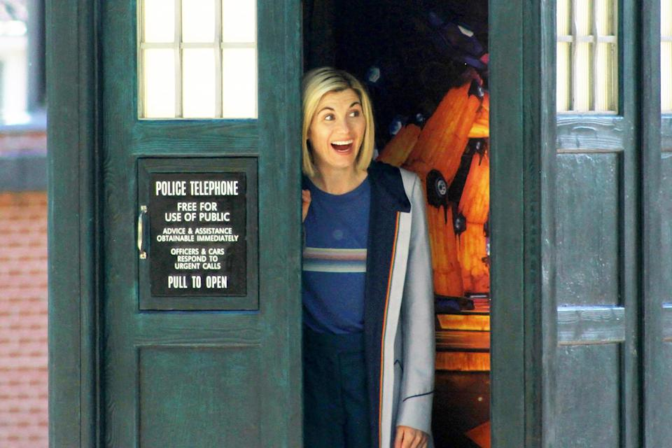 <p>Jodie Whittaker smiles on set while shooting <em>Doctor Who</em> in Cardiff, Wales, on Sept. 20.</p>