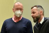 German sports doctor Mark S. (L), accused of masterminding an international doping network in cycling and winter sports, speaks with his lawyer Alexander Dann as he waits for the verdict in his trial at the Regional Court (Landgericht) in Munich