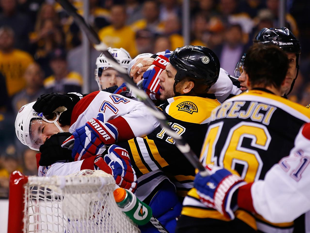BOSTON, MA - MAY 03: Milan Lucic #17 of the Boston Bruins shoves Alexei Emelin #74 of the Montreal Canadiens into the goal in the third period in Game Two of the Second Round of the 2014 NHL Stanley Cup Playoffs at TD Garden on May 3, 2014 in Boston, Massachusetts. (Photo by Jared Wickerham/Getty Images)