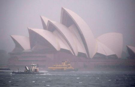 Ferries and boats pass in front of the Sydney Opera House as strong winds and heavy rain hit the city of Sydney, Australia, November 28, 2018.    REUTERS/David Gray