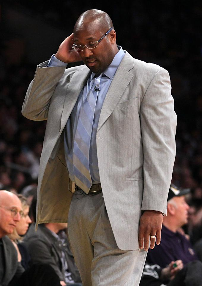 LOS ANGELES, CA - MAY 08:  Head coach Mike Brown of the Los Angeles Lakers reacts as he walks down the sideline in the first quarter while taking on the Denver Nuggets in Game Five of the Western Conference Quarterfinals in the 2012 NBA Playoffs on May 8, 2012 at Staples Center in Los Angeles, California. NOTE TO USER: User expressly acknowledges and agrees that, by downloading and or using this photograph, User is consenting to the terms and conditions of the Getty Images License Agreement.  (Photo by Jeff Gross/Getty Images)