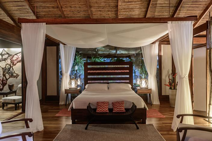 """<p>For a Costa Rican getaway that's as luxe as it is eco-friendly, <a href=""""https://cna.st/affiliate-link/UeYxRXY6kTFdeTLeao77FPVB5a4hhDJwjTRZCGGAoJAb1xRBusJTPQGSTtvMdhq4KcgA7iPq4ifM5tr?cid=60887d46aa9876bf2b110cba"""" rel=""""nofollow noopener"""" target=""""_blank"""" data-ylk=""""slk:Pacuare Lodge"""" class=""""link rapid-noclick-resp"""">Pacuare Lodge</a> in Siquirres, Costa Rica is a jungle respite of 20 open-air villas lit only by candlelight at night, and accessible only by helicopter or river raft. Wi-Fi is limited but available in the central lodge where inclusive meals are served, and sleeping in the privacy of a sprawling, screened-in suite (complete with outdoor shower and private plunge pool) means falling asleep to the sounds of the rushing Pacuare River and the surrounding protected forest's monkeys, jaguars, and insects. Activities like waterfall hikes, canopy zip-line tours, and on-site spa treatments will make you forget all about the lack of electricity and internet.</p> <p><strong>Book now:</strong> <a href=""""https://cna.st/affiliate-link/WHvUKwsURK2Vm8hnqtb3MnA61BEzaM3JwN5vXrsebs3zZSCjowtrHf9bbTsuuXhZ3QZNuUFG1JCUqtfzZEKKcuj2GvpjuxwEpt4XP8r7NULYhwz4VVMTLZnCFikgqQsqey8EjeYPLhdeCbGiRX5bZf?cid=60887d46aa9876bf2b110cba"""" rel=""""nofollow noopener"""" target=""""_blank"""" data-ylk=""""slk:expedia.com"""" class=""""link rapid-noclick-resp"""">expedia.com</a></p>"""